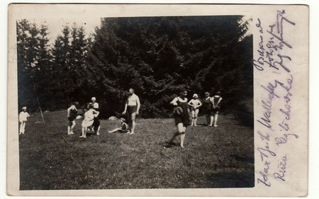 SLIAC, THE CZECHOSLOVAK REPUBLIC - AUGUST 6, 1921: Vintage photo shows people during summer time. People wear period swimsuit and have a rest during vacation.