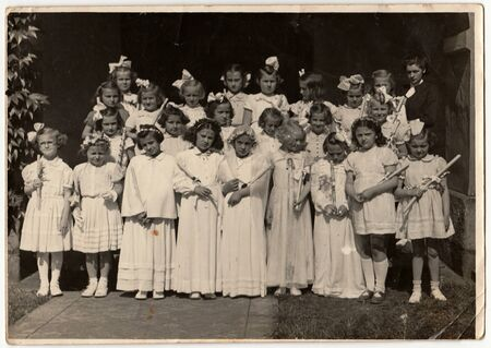 THE CZECHOSLOVAK SOCIALIST REPUBLIC - CIRCA 1950s: Retro photo shows girls and their first communion. Black & white vintage photography. Éditoriale