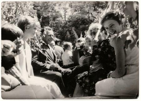 THE CZECHOSLOVAK SOCIALIST REPUBLIC - CIRCA 1970s: Retro photo shows people ride on rural wedding celebration. Black & white vintage photography.