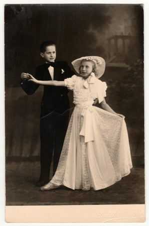 TABOR, THE CZECHOSLOVAK REPUBLIC - CIRCA 1940s: Vintage photo shows a dancing couple (children). A young couple takes dancing lessons. Retro black & white photography.