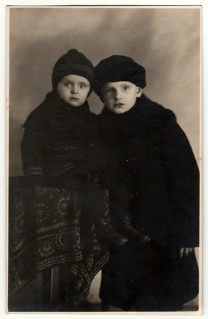 THE CZECHOSLOVAK REPUBLIC - DECEMBER 23, 1922: Vintage photo shows two small boys (2 and 8 years old). Retro black & white photography. Editorial