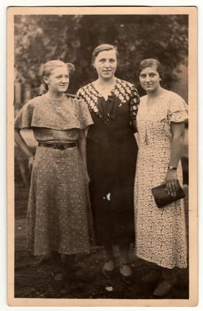 THE CZECHOSLOVAK REPUBLIC -  CIRCA 1940s: Vintage photo shows three mature woman poses outdoors. Retro black & white photography. Editorial