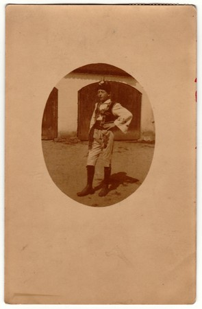 historical events: PRAHA (PRAGUE), AUSTRIA-HUNGARY - SEPTEMBER 29, 1918: Vintage photo shows a young boy wears traditional Moravian folk costume. Retro black & white photography. Photo was taken in Austro-Hungarian Empire or also Austro-Hungarian Monarchy.