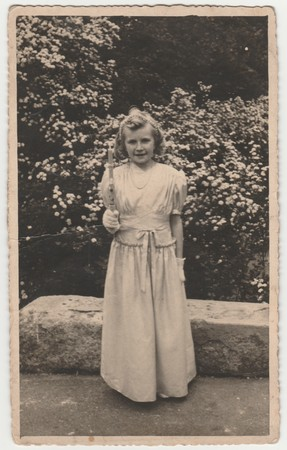 THE CZECHOSLOVAK  REPUBLIC - CIRCA 1940s: Vintage photo shows girl after her first communion. Retro black & white  photography. Editöryel