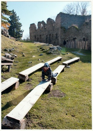THE CZECHOSLOVAK REPUBLIC - CIRCA 1990s: Retro photo shows small boy in front of ancient castle (ruins) Boy on an autumn trip. Holiday (vacation) trip. Vintage color photography. Editorial