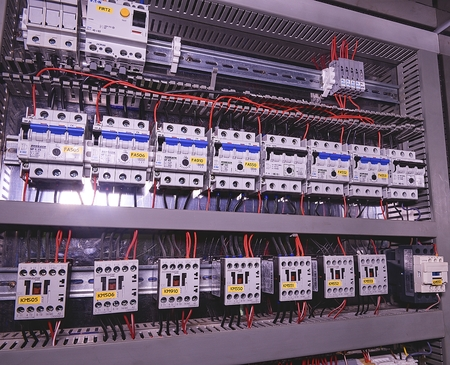 Image shows circuit breakers and electrical contactors, brand SCHRACK. Close-up. Modern distribution case. Contorl cubicle. Editoriali