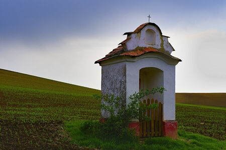 moravia: Fairytale spring landscape with chapel in the fields. Moravian Tuscany, south Moravia, Czech Republic, Europe.