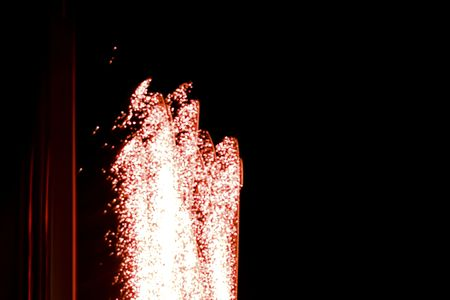 Red abstract firework. Free copy space for text.