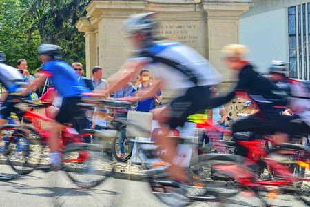 Abstract arty background : motion blur of bicycle racers competing on city streets. Tour of cycling. Blurry background sport with cyclists Stock Photo