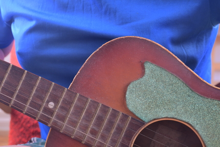 Man playing acoustic guitar. Musical concept. Close-up. Stock Photo