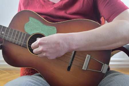 Close up of guitarist hand playing acoustic guitar. Musical concept