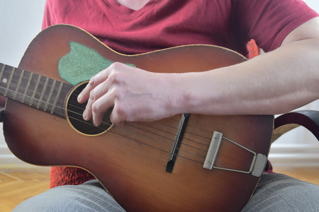 Man playing guitar. Musical concept. Close-up.