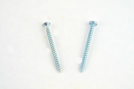 Set of screws for construction on a white background, metal screw, iron screw, chrome screw, screws as a background, wood screw. Close-up