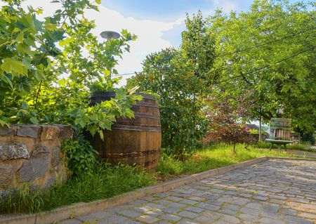 Old wine press and rustic wine barrel. Wine background in Europe. Czech Republic, South Moravia