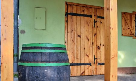 Old rustic wine barrel. Wine background in Europe. Czech Republic, South Moravia
