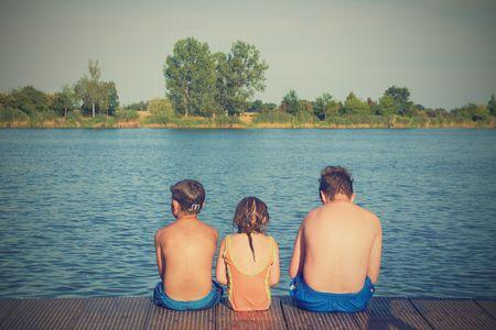 Children sitting on pier.