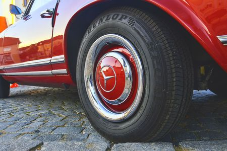 Mercedes Benz logo on vintage car wheel. Mercedes-Benz is a German automobile manufacturer. The brand is used for luxury automobiles, buses, coaches and trucks. Editorial