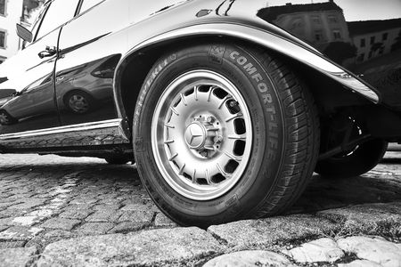 Mercedes Benz logo on vintage car wheel. Semperit logo on tyre. Mercedes-Benz is a German automobile manufacturer. The brand is used for luxury automobiles, buses, coaches and trucks. Black white image. Editorial