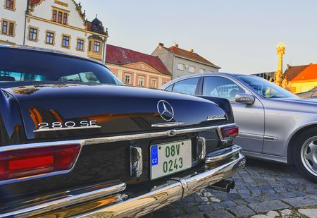 Mercedes Benz logo on a black vintage car. Mercedes-Benz is a German automobile manufacturer. The brand is used for luxury automobiles, buses, coaches and trucks.