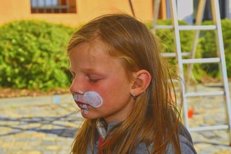 Beautiful young girl with face painted like a rabbit.  Face painting on child face. Stockfoto