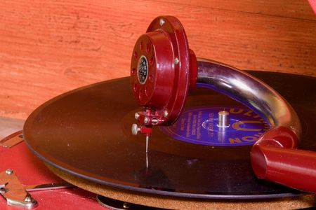 Image shows vintage gramophone famous Czech brand Supraphone. The red wind-up gramophone and vinyl record brand Ultraphon .