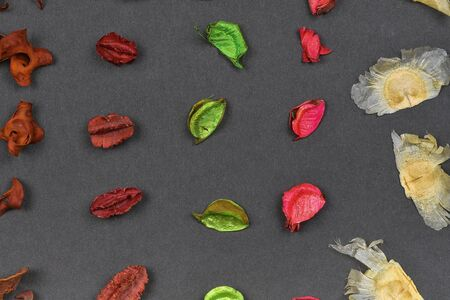Dry aromatic potpourri leaves close-up. Background of colored aromatic potpourri leaves. Geometric pattern - raws. Imagens