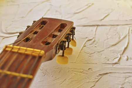 Old acoustic guitar head with tuning pegs. Copy space. Warm and vivid colors 版權商用圖片