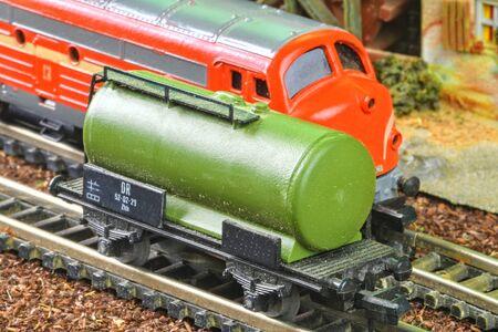Railway tanker truck. Train hobby model on the model railway. Close-up. Stock Photo