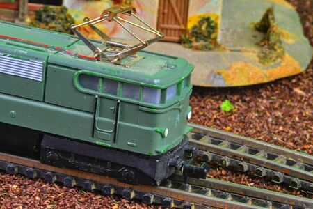 Perfect model of the electric locomotive. Train hobby model on the model railway. Close-up.