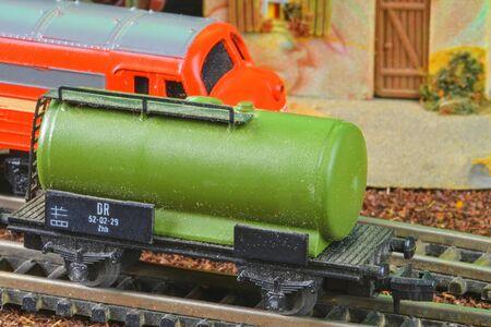 Railway tanker truck. Train hobby model on the model railway. Close-up