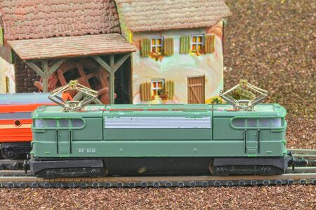 Perfect model of the electric locomotive. Train hobby model on the model railway. Close-up