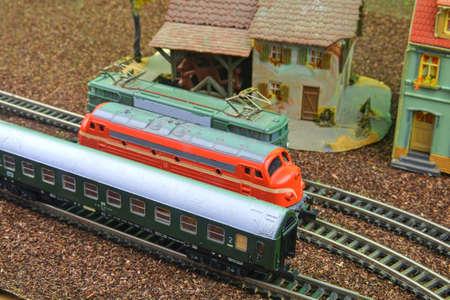 Train hobby models on the model railway. Close-up of model railway carriage on the rail tracks. Perfect model of the diesel locomotive. Train hobby model on the model railway