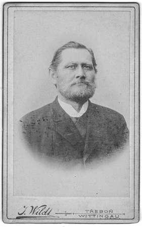 TREBON, CZECHOSLOVAKIA - CIRCA 1920: Vintage cabinet card shows portrait of the mature man. Photo was taken in a photo studio.