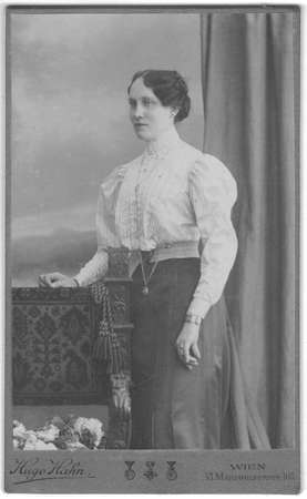 VIENNA, AUSTRIA - HUNGARY - CIRCA 1910: Vintage cabinet card shows portrait of the middle-aged woman. Photo was taken in a photo studio. Edwardian hairstyle. Photo was taken in Austro-Hungarian Empire or also Austro-Hungarian Monarchy.
