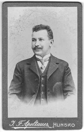 HLINSKO, AUSTRIA - HUNGARY - CIRCA 1910: Vintage cabinet card shows portrait of the middle-aged man with mustache. Photo was taken in a photo studio. Edwardian era. Photo was taken in Austro-Hungarian Empire or also Austro-Hungarian Monarchy. Editorial