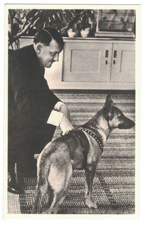 HAUS WACHENFELD, GERMANY - CIRCA 1940: Adolf Hitler and his dog. Hitler was leader of nazi Germany. Reproduction of antique photo. Editorial