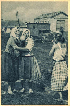The victims of war. Crying women with children.