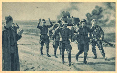 German forces launched Operation Barbarossa, the Axis invasion of the Soviet Union. The Soviet soldiers are captured by German troops. On the background is detroyed an army tank