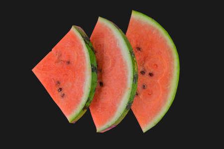 Sliced watermelon on black background. Pieces of watermelon isolated on black background. Flat lay Standard-Bild
