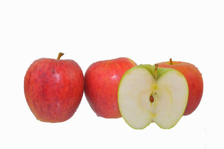 Fresh ripe red and green apples isolated on white. Red apples isolated on white background, clipping path, full depth of field Standard-Bild