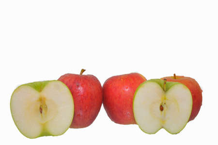 Red and green apples with half isolated on white background. Red apples isolated on white background, clipping path, full depth of field Standard-Bild