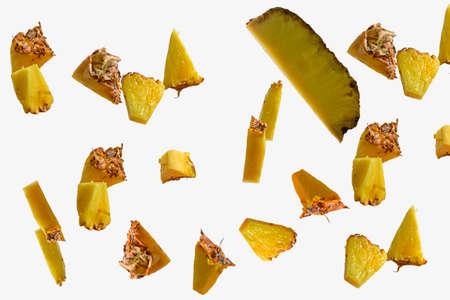 Flying pineapple slices set on white background. Falling pineapple slice isolated on white background, path, full depth of field
