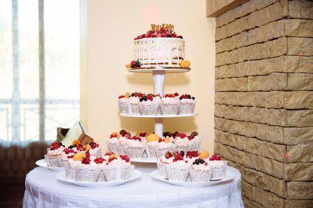 multilevel: Sweets multilevel wedding cake decorated with flowers
