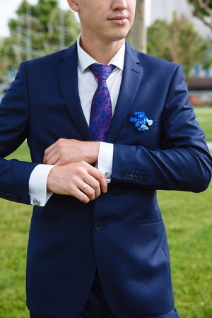 cuff link: Business man hands with cufflinks. Elegant gentleman clother