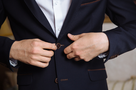 tailored: man wears a black jacket. concept of business