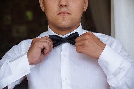 seducer: Elegant gentleman clother. shirt and bow tie Stock Photo
