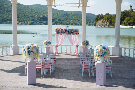 the place is outdoor: outdoor place for wedding ceremony.