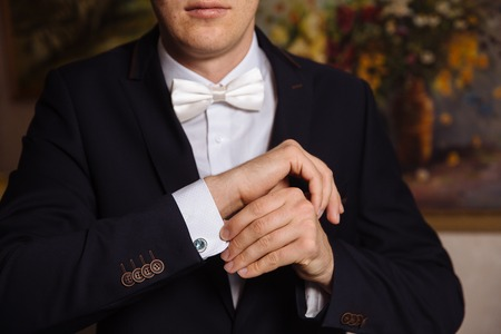 cuffs: Business man hands with cufflinks. Elegant gentleman clother