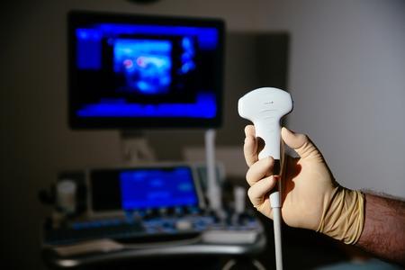 Ultrasonic investigation medical device for diagnostics in doctor hands. Hospital equipment Stock fotó