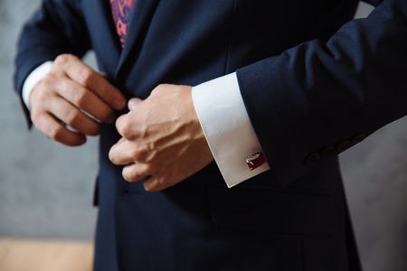 cuff links: Business man hands with cufflinks. Elegant gentleman clother